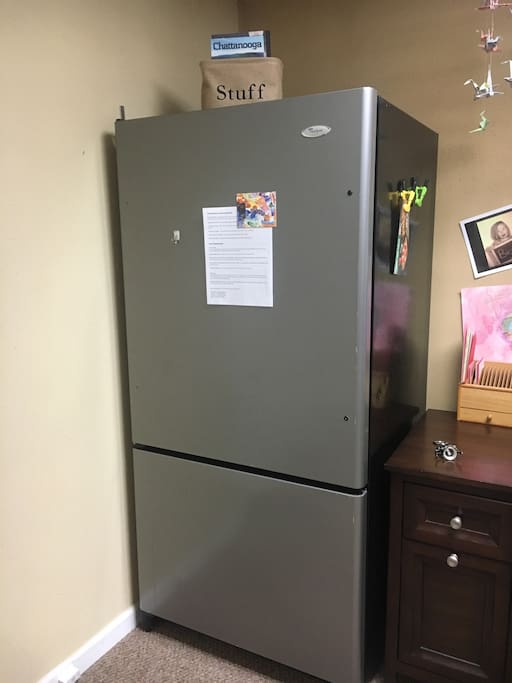 Full size refrigerator (some basic condiments) and freezer.