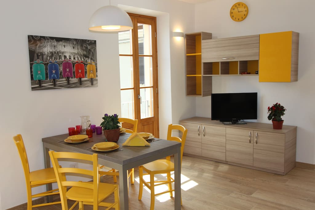 Dining area and TV corner with French windows