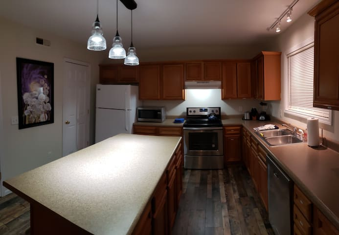 Spacious fully equipped  kitchen, large working island for food prep or family gatherings.  Custom lighting and art.