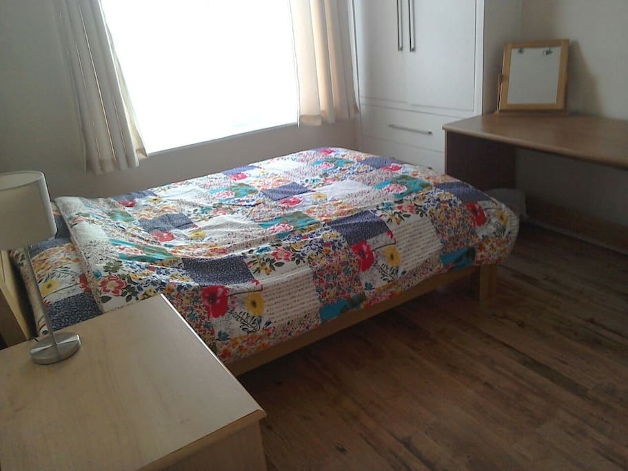 Spacious double room with good sized desk.