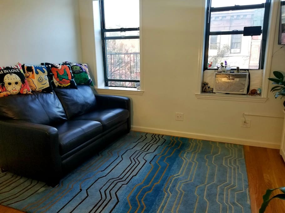 """Bedroom 2/2; Full size couch (closed) Air Conditioner, 36"""" 4K UHD Samsung Smart Tv (Hulu Amazon, Netflix), blu ray/DVD player"""