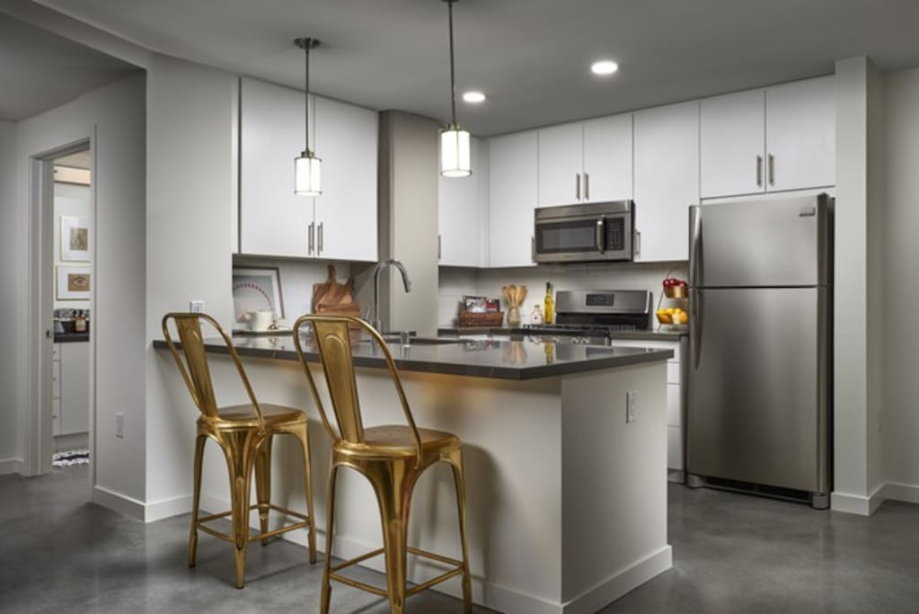 Bright Spacious Kitchen with Modern Stainless Steel Appliances