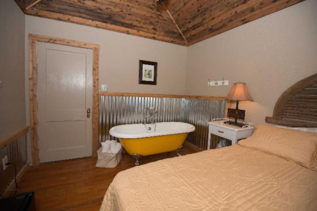 Bedroom with two person tub in the Peachick Suite.