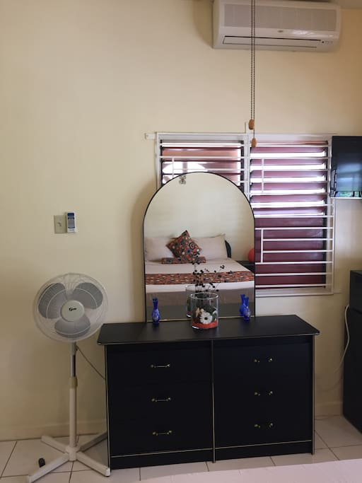 Choose your pick! A/C unit, Ceiling or Standing Fan to keep you cool, while you unpack all your stuff in a roomy dressing table.