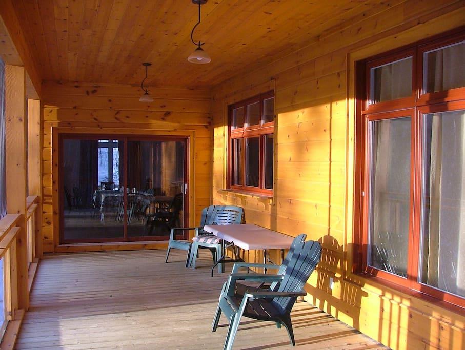 Upper level screened in verandah overlooking lake (south west exposure)