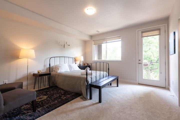 Queen Bedroom Suite with Balcony in Luxury Home