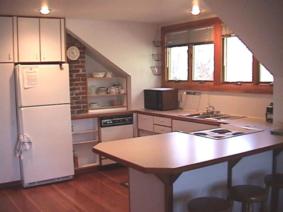 The kitchen is large for a studio!