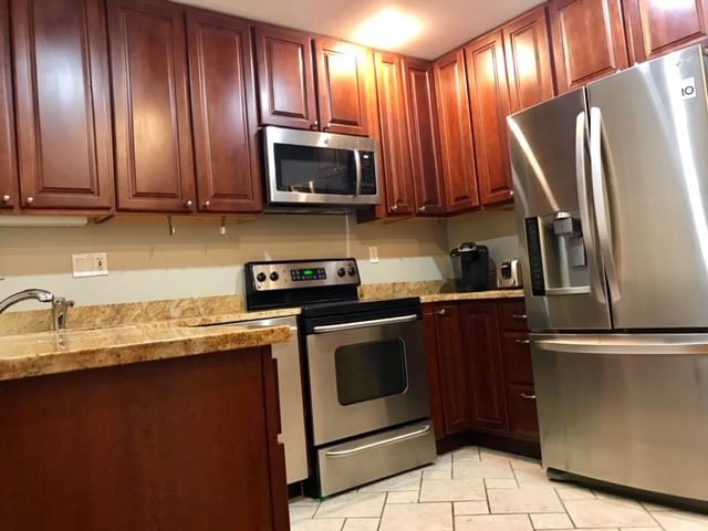 Newly renovated kitchen with dishwasher, fridge, stove and microwave