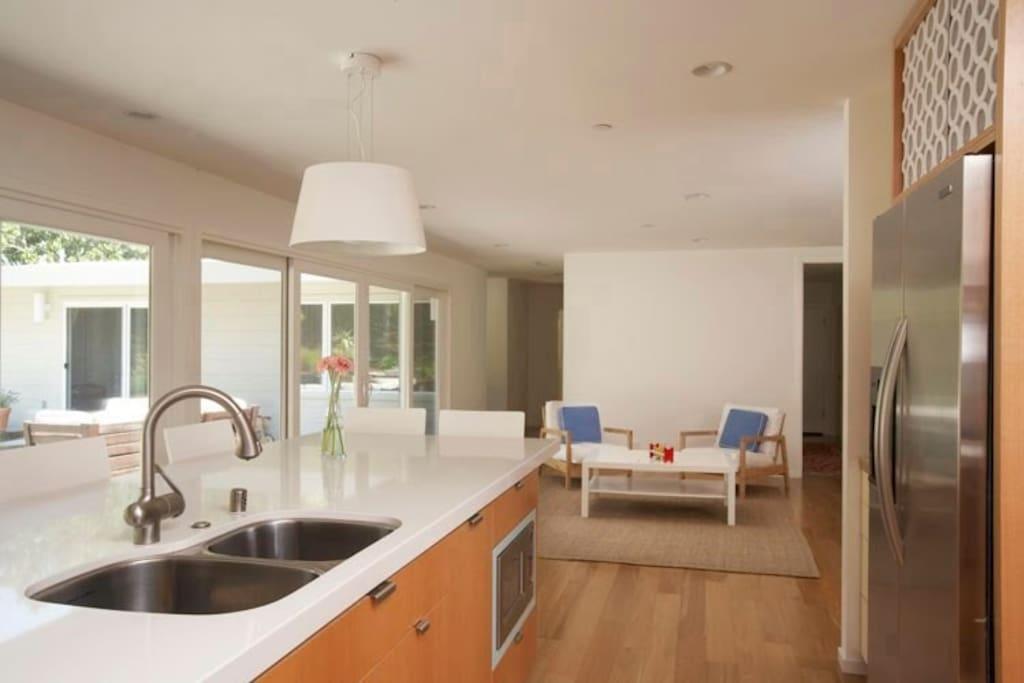Kitchen view towards indoor lounge area