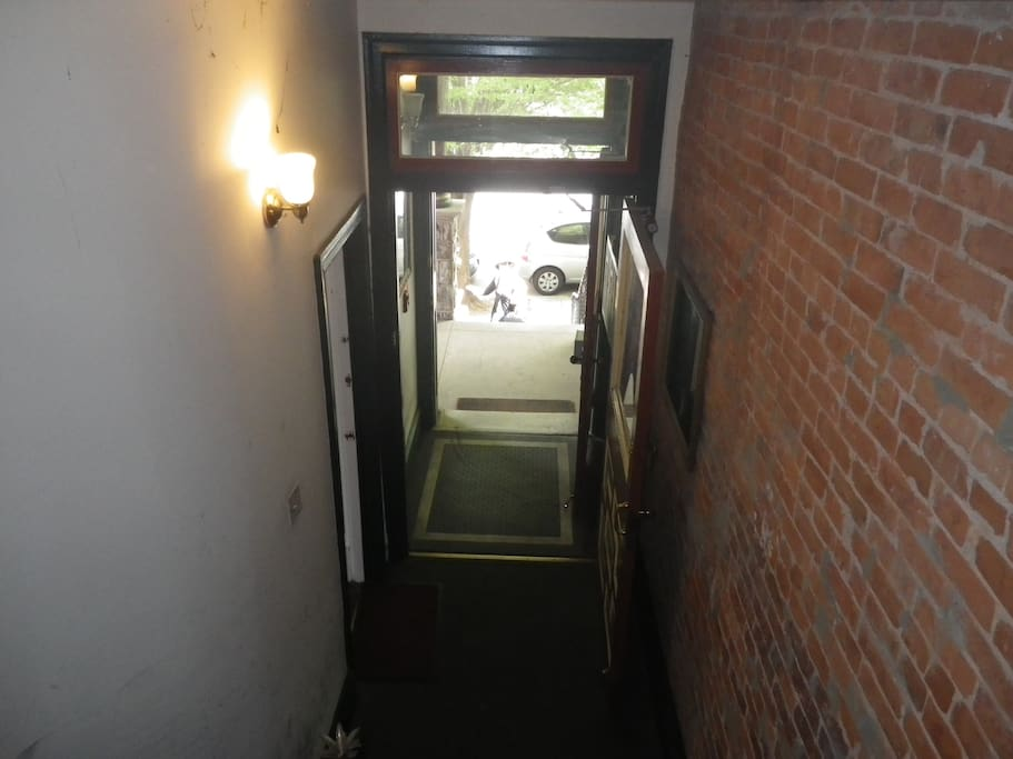 The Apartment Entrance is on the right after you pass through the Vestibule.