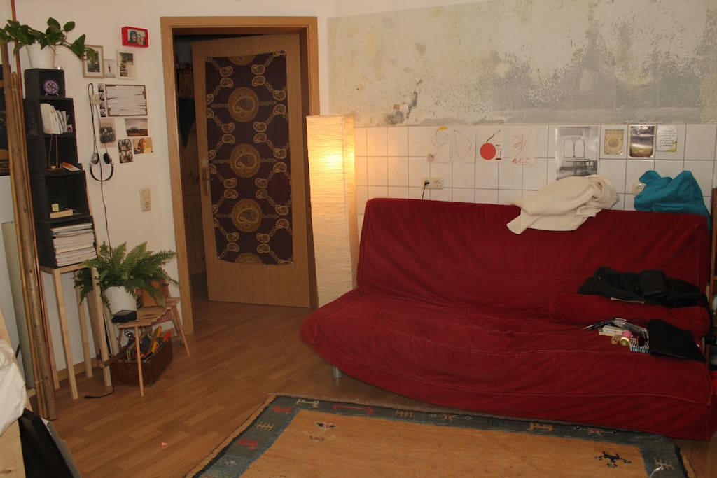 Here you can see the red sleeping-couch. when unfolded it has space for two people