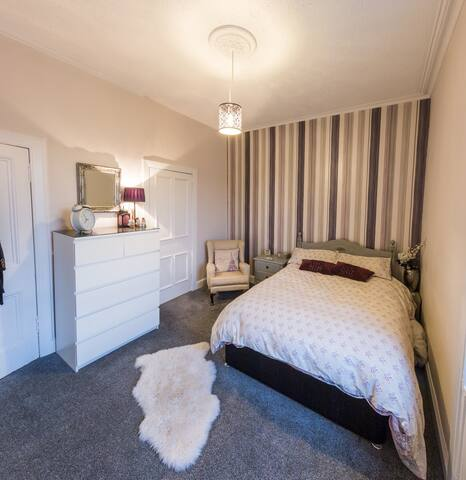 Bedroom with double bed and storage space