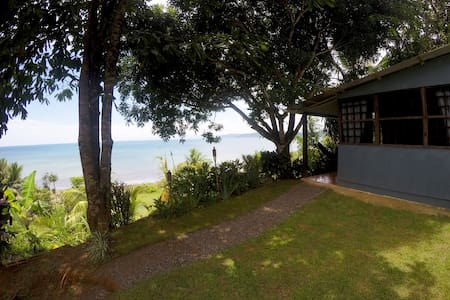Our Cabin is situated on a hill overlooking Drake's Bay on the Osa Peninsula of the Pacific Coast of Southern Costa Rica. The Cabin has one of the most spectacular views in Drake's Bay. We are located just 200 meters from the ocean