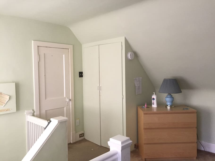 closet, chest of drawers in attic room