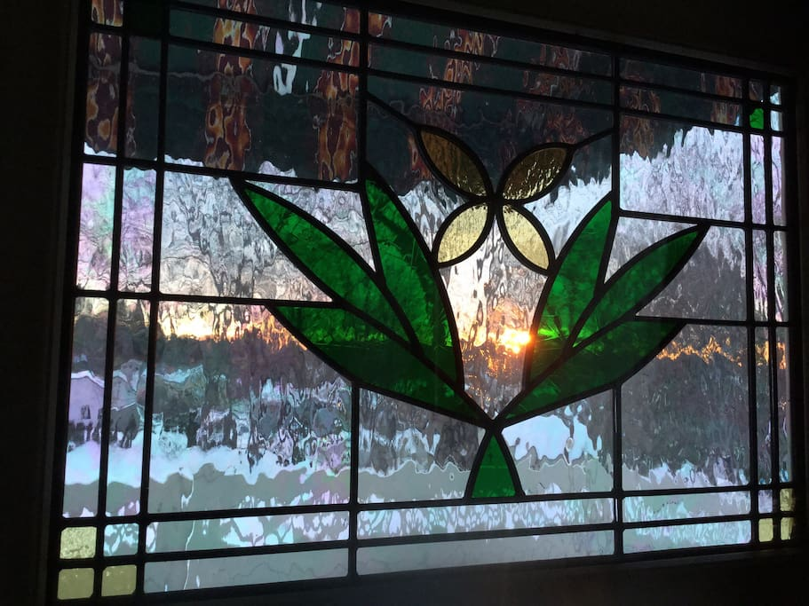Sunrise through stained glass door.