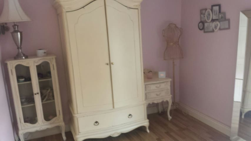 Spacious wardrobe and two sets of drawers.