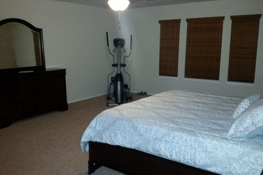 Spacious Master Bedroom connects with upstairs family room and master bathroom (double vanity, garden tub, separate shower, walk-in closets).