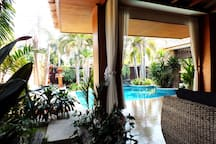 Outside Sofa Area Looking On To Private Pool