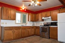Kitchen has full size stove, fridge, and sink, and is stocked with all basic cookware and dishes.  Coffee maker and toaster provided.