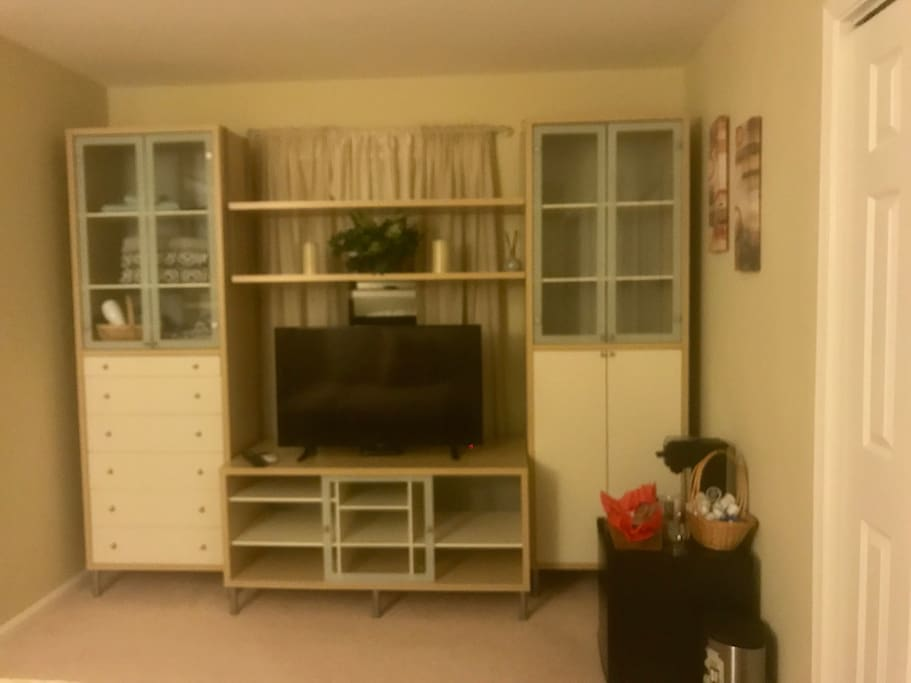 Nice 40 inch smart TV plenty of storage space in large wall unit with draws.