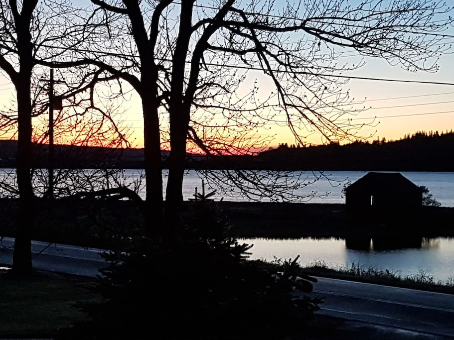Wake up to spectacular sunrises... view from the house looking across to the water!