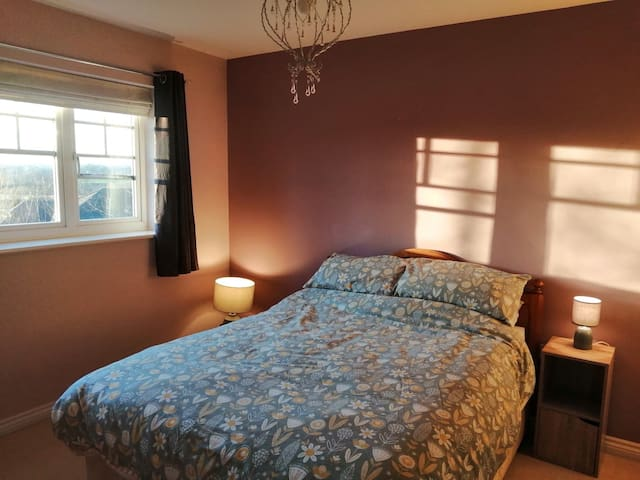 One double bedroom boasts fitted wardrobes, and a large window overlooking the garden.