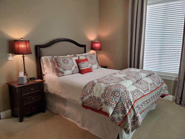 Cozy bedroom with views of the rolling hills of Fallbrook. Walk-in closet.