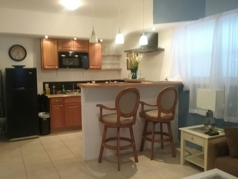 Bar over looking kitchen