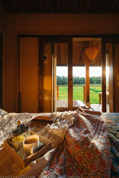 Breakfast in bed with a view of the sunrise over the rice paddies.