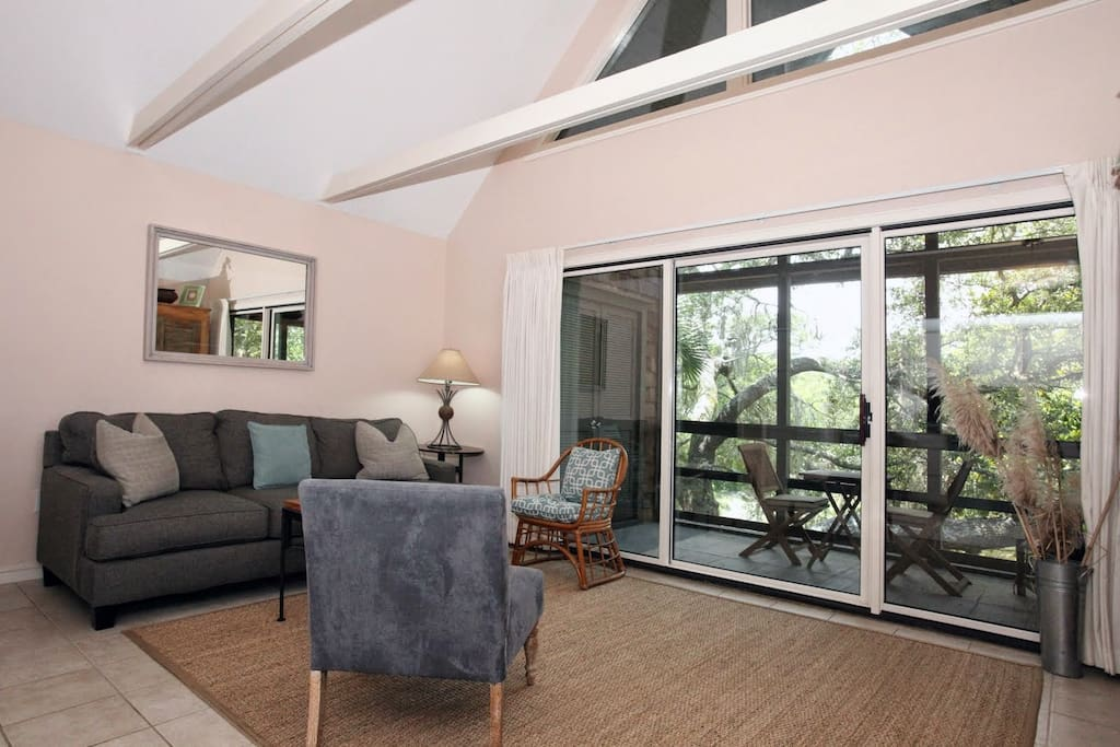Open living area with vaulted ceilings and queen sleeper sofa