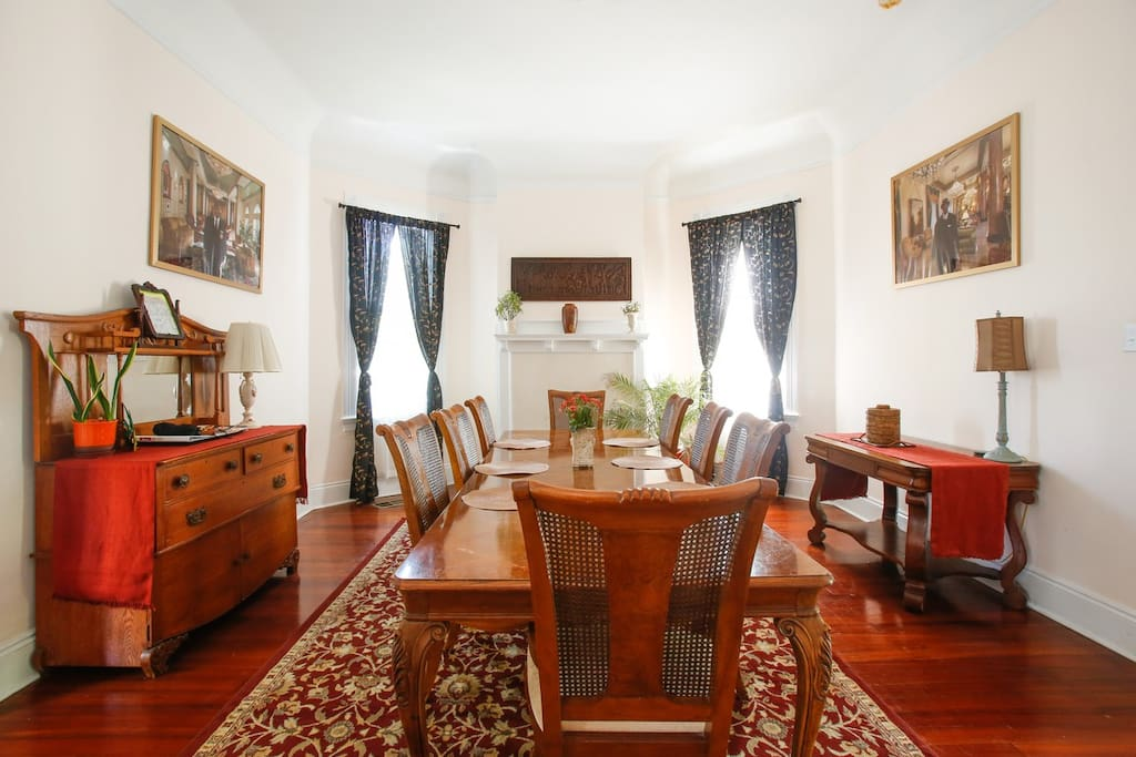 Sunny dining room with comfortable seating for 10