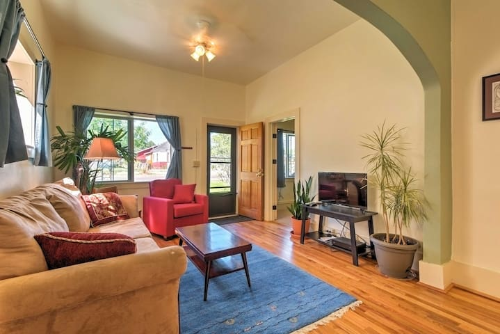 The living room is open and airy, with an abundance of natural light.