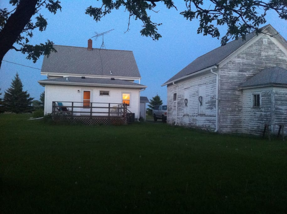 Our backyard behind the 1890 schoolhouse and deck. Frisbee included.