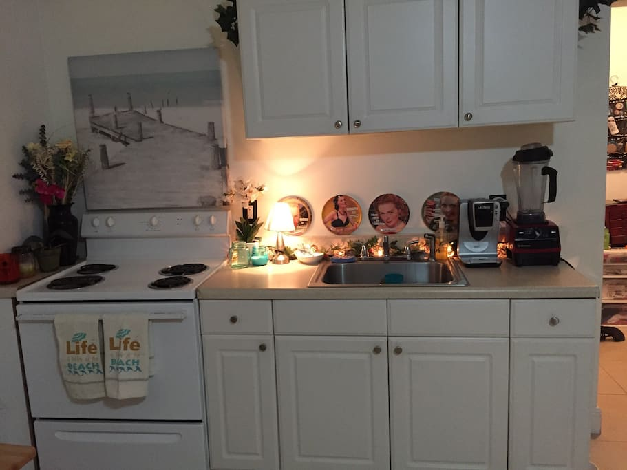 Full size kitchen with microwave, toaster, and coffee maker.