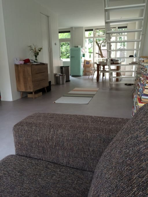 Large open living room with spacious terrace out back (couch is suitable for sleeping one person)