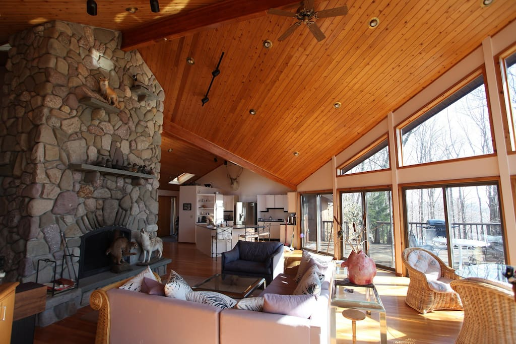 Mainroom looking toward kitchen area, lounge around the fireplace or walk the 1000sq ft deck outside