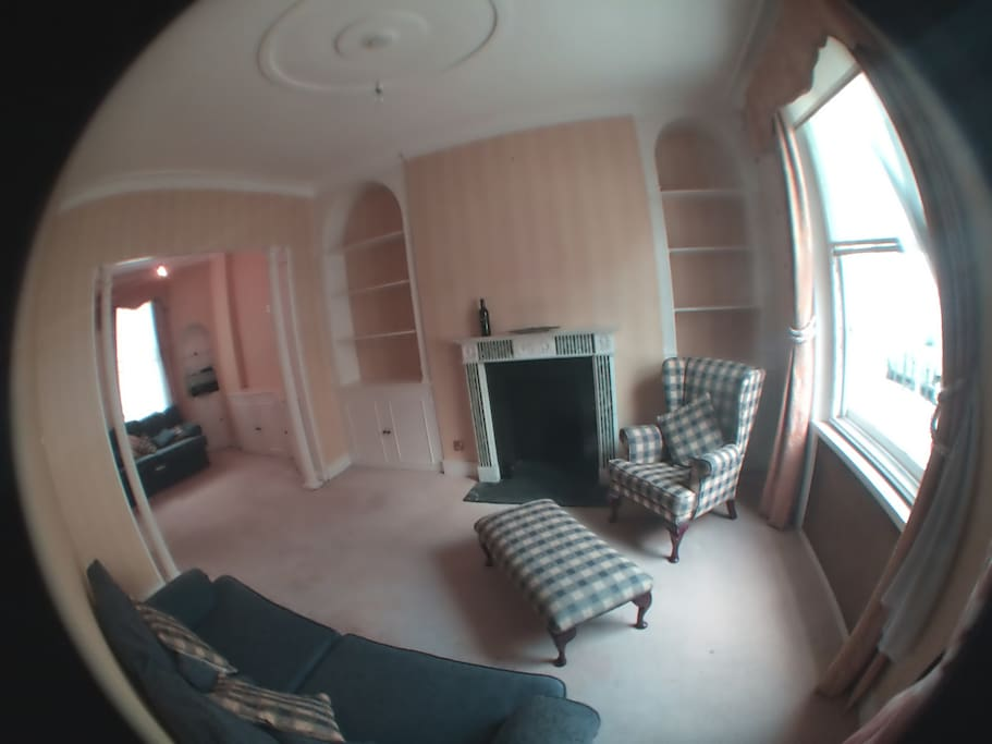 Lovely double aspect living room with dining area