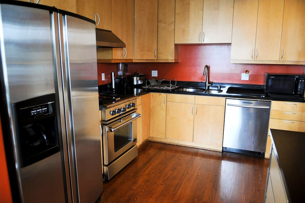 High quality kitchen appliances and fully stocked with cooking utensils.