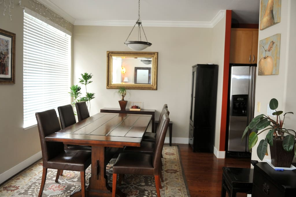 Beautiful pottery barn table with adjacent open kitchen