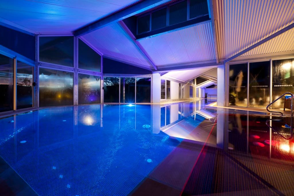 The 33m Heated Indoor Pool and Spa at Night a few steps away from your suite.