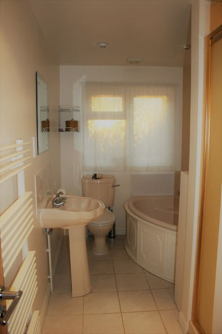 Private bathroom with separate shower cubicle