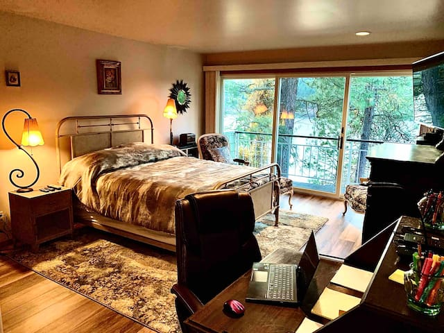 """Queen bed with antique desk (color photo printer, copier, scanner, office supplies) leather office chair, two armchairs, ottoman, private deck, walk in closet, 4K 55"""" Smart TV and view of lake and Kidd Island"""
