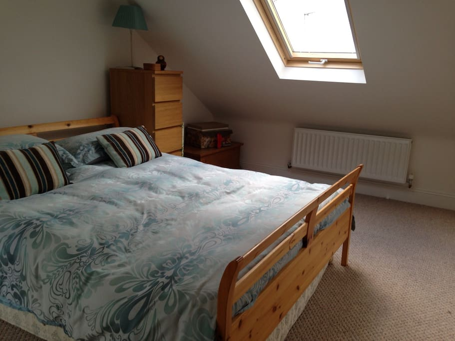 King size bed and light airy room with velux windows.