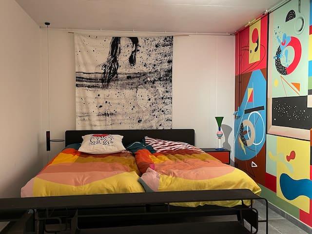 Large bedroom with floor paintings