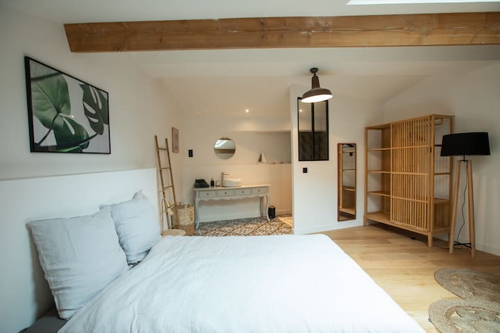 Upper part of the open concept design space is reserved of the comfortable bedroom.