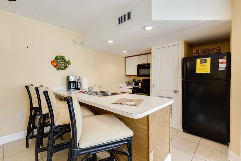 Full kitchen has new appliances and all cookware and dishware is provided.
