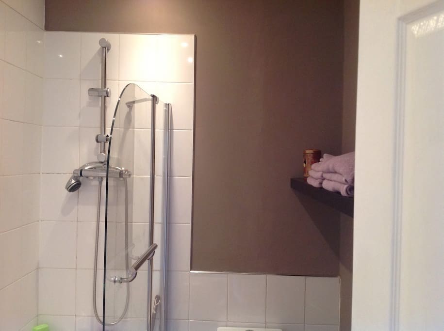 Bathroom with bath, shower and toilet, new soft cotton towels provided