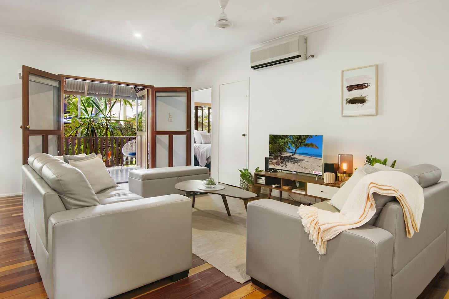 Open plan living room looking out onto front verandah