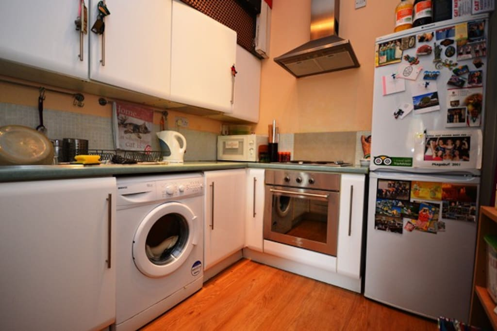 Kitchen - included washing machine, electric oven, microwave, and large fridge-dreezer