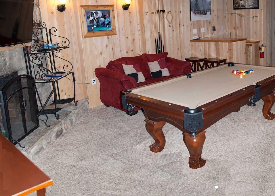 Game room wood burning fireplace, bar, pool table